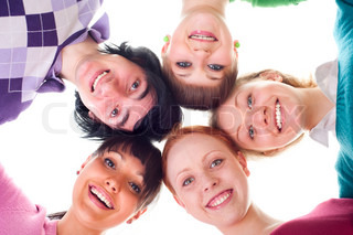 group of happy young people in circle