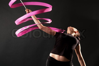 gymnast with pink ribbon