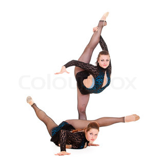 two young women showing rhythmic gymnastics isolated on white background