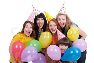 happy girls with variegated balloons