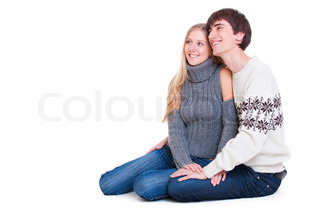smiley happy couple sitting on the floor