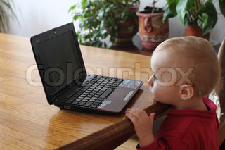 Little boy looking at PC