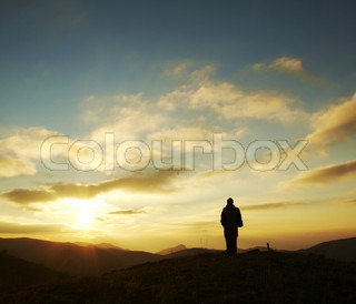 Girl silhouette on sunrise