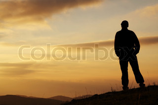 Men on the sunset background