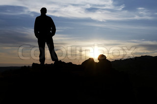 Men silhouette on suset