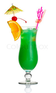 Green alcohol cocktail with orange slice and umbrella isolated