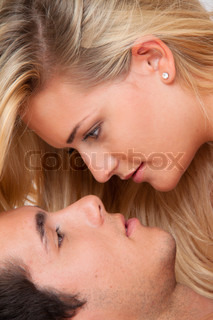 couple in bed during sex and affection love and e