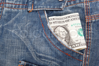 Dollar bill in his pocket jeans