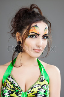 beautiful girl in green dress and with indian make up