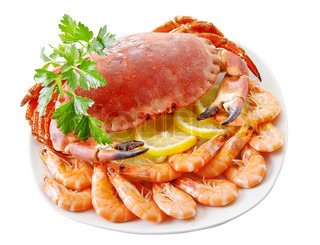 Crab with shrimp and parsley on a white background.