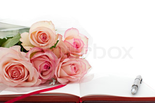 pink roses on the book