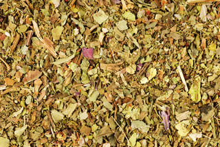 Pile of ground dried Basil Sweet Basil as background Used as a spice in culinary herb all over the world The plant is also used in medicine