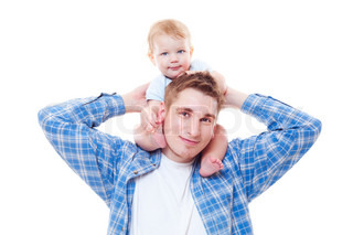 studio shot of little boy sitting on shoulders of his father