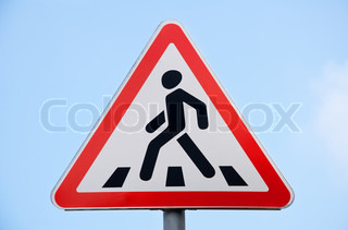 road sign pedestrian crossing against the blue sky