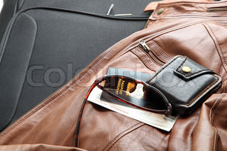 Leather jacket with travel necessities ready to travel