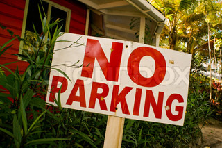 No Parking sign in front of a house