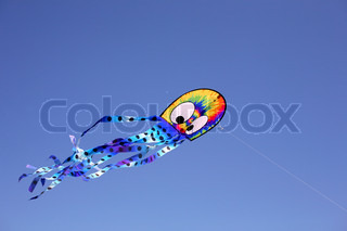 colourful octopyssy wind kite in clear blue sky