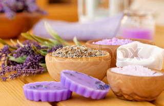 dry Lavender herbs and bath salt, on wooden background