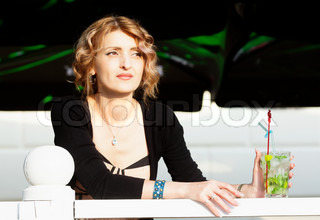 Woman in summer cafe