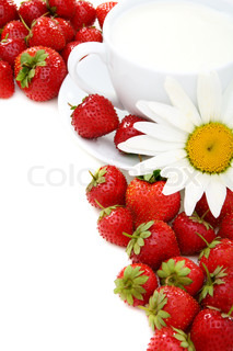Ripe strawberries, cup of cream and chamomile
