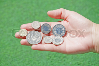 Total set of swiss franc coins hold in open hand