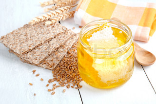 honey with crispbread and wheat grain
