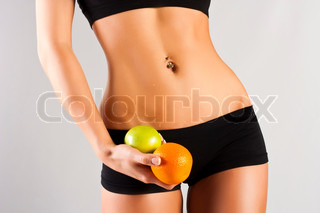 Concept of a healthy body Thin belly, fruit