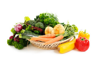 a basket filled with vegetables isolated on white