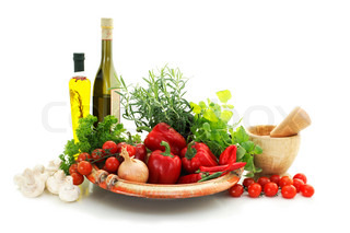 appetizing italian style raw vegetables, herbs and bottles of olive oil and vinegar