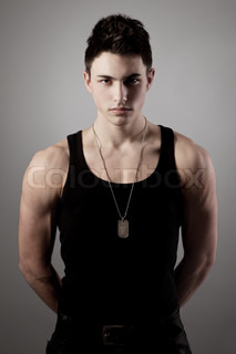 Muscular built man with a dog tags