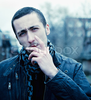 Portrait of smoking handsome young man