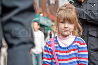 Young girl's face in crowd