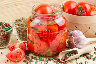 Homemade tomatoes preserves in glass jar Canned tomatoes
