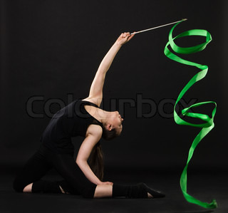 beautiful gymnast with green ribbon