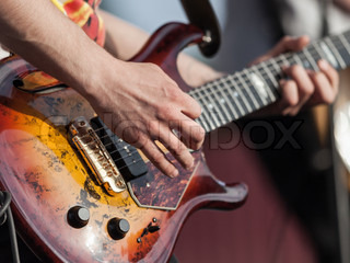 Musician or guitarist playing guitar string music instrument