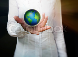 female hand holding globe over black background - environment protection and travel concept -Elements of this image furnished by NASA