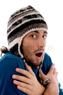 smart young guy in winter cap shivering from cold