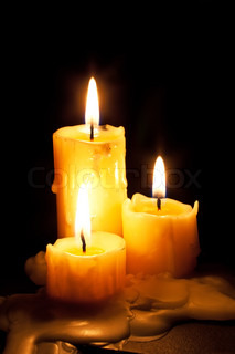 Three old white candles