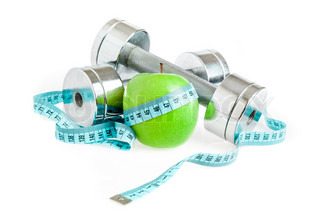 Dumbbells and apple A healthy way of life