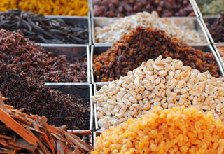 Dry fruits & spices displayed for sale in a bazaar
