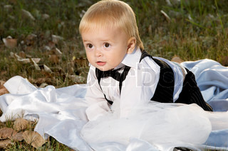 Boy inthe groom in a suit