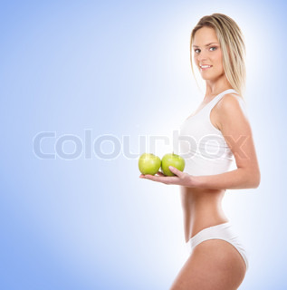 Young sexy girl with exotic fruit over blue