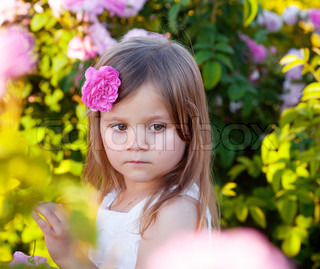 Girl in rose garden