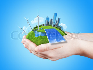 Hands holding clear green meadow with sun battery block, wind mill turbines and city skyscrapers. Concept for ecology, growing business, freshness, freedom and other lifestyle issues. Green fields collection.