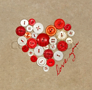Old plastic buttons in a heart shape