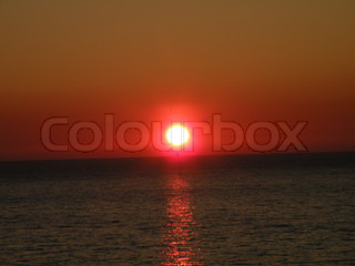 orang and red sky with sunset over the sea in denmark