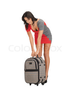 unhappy woman with heavy suitcase