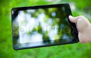 Close-up photo of tablet computer outdoor