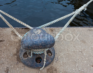 Mooring bollard with heavy rope stock photo colourbox for Heavy rope for nautical use