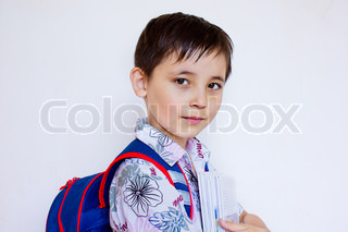 a boy with a backpack and books